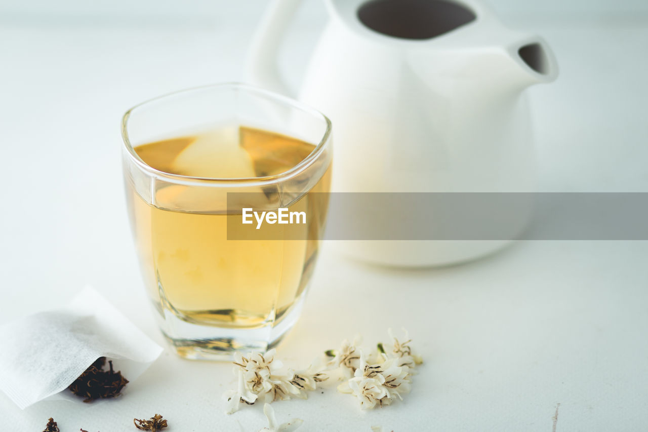 Close-up of herbal tea on white background