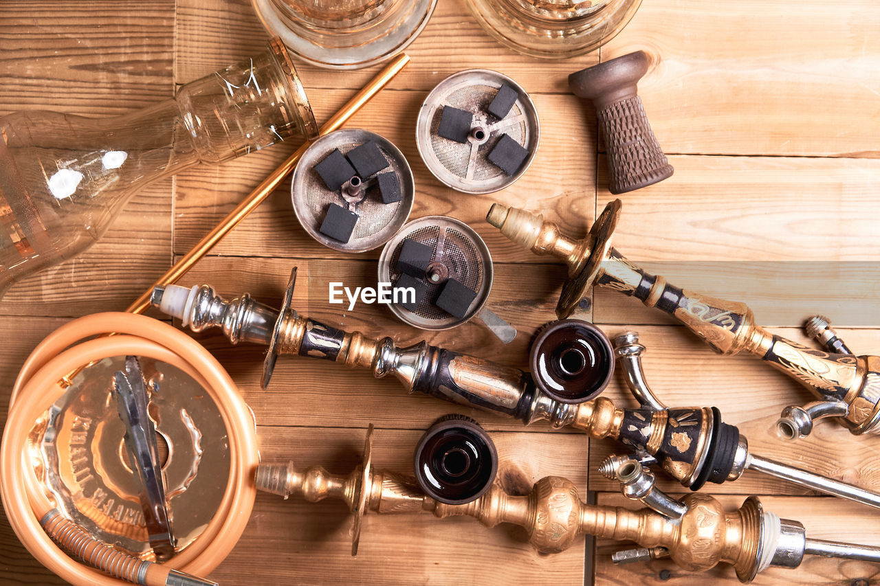 indoors, choice, wood - material, table, variation, no people, high angle view, directly above, large group of objects, metal, studio shot, collection, close-up, still life, equipment, healthcare and medicine, group, group of objects, bullet, aggression, chaos