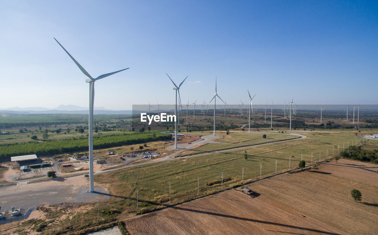 fuel and power generation, wind turbine, environment, turbine, renewable energy, alternative energy, wind power, environmental conservation, sky, landscape, field, rural scene, land, day, nature, no people, technology, outdoors, beauty in nature, architecture, sustainable resources