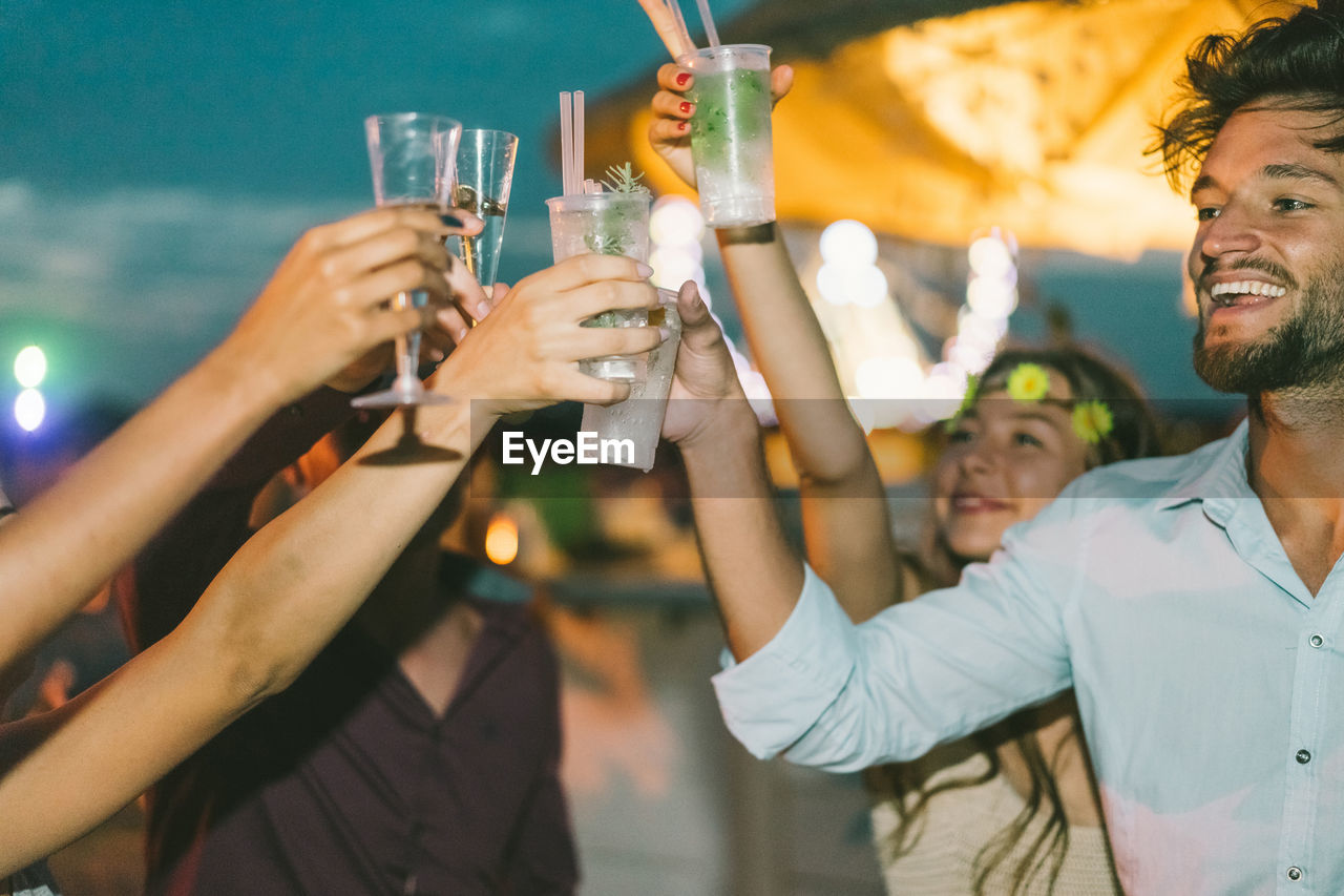 Friends Toasting Drink In Party At Night