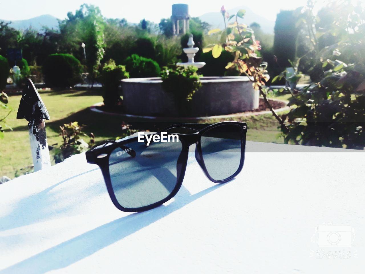 sunglasses, eyeglasses, eyewear, sunlight, summer, tree, no people, reflection, day, outdoors, eyesight, glasses, nature, close-up, sky
