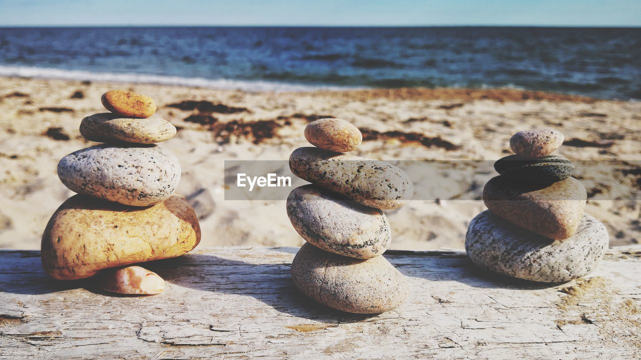 land, beach, sea, horizon over water, horizon, stack, stone - object, zen-like, balance, solid, stone, water, nature, pebble, tranquility, rock, no people, sky, day, scenics - nature, outdoors