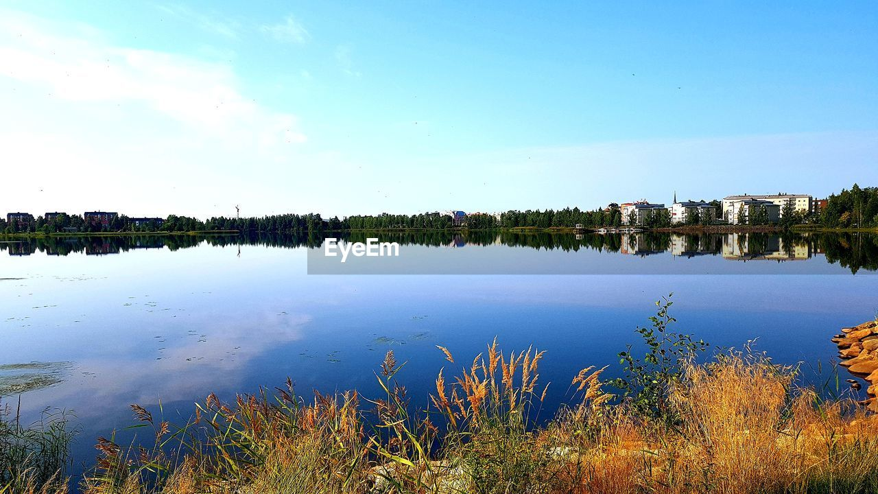 water, sky, plant, reflection, nature, tranquility, scenics - nature, beauty in nature, architecture, blue, tranquil scene, no people, built structure, lake, building exterior, cloud - sky, day, building, outdoors