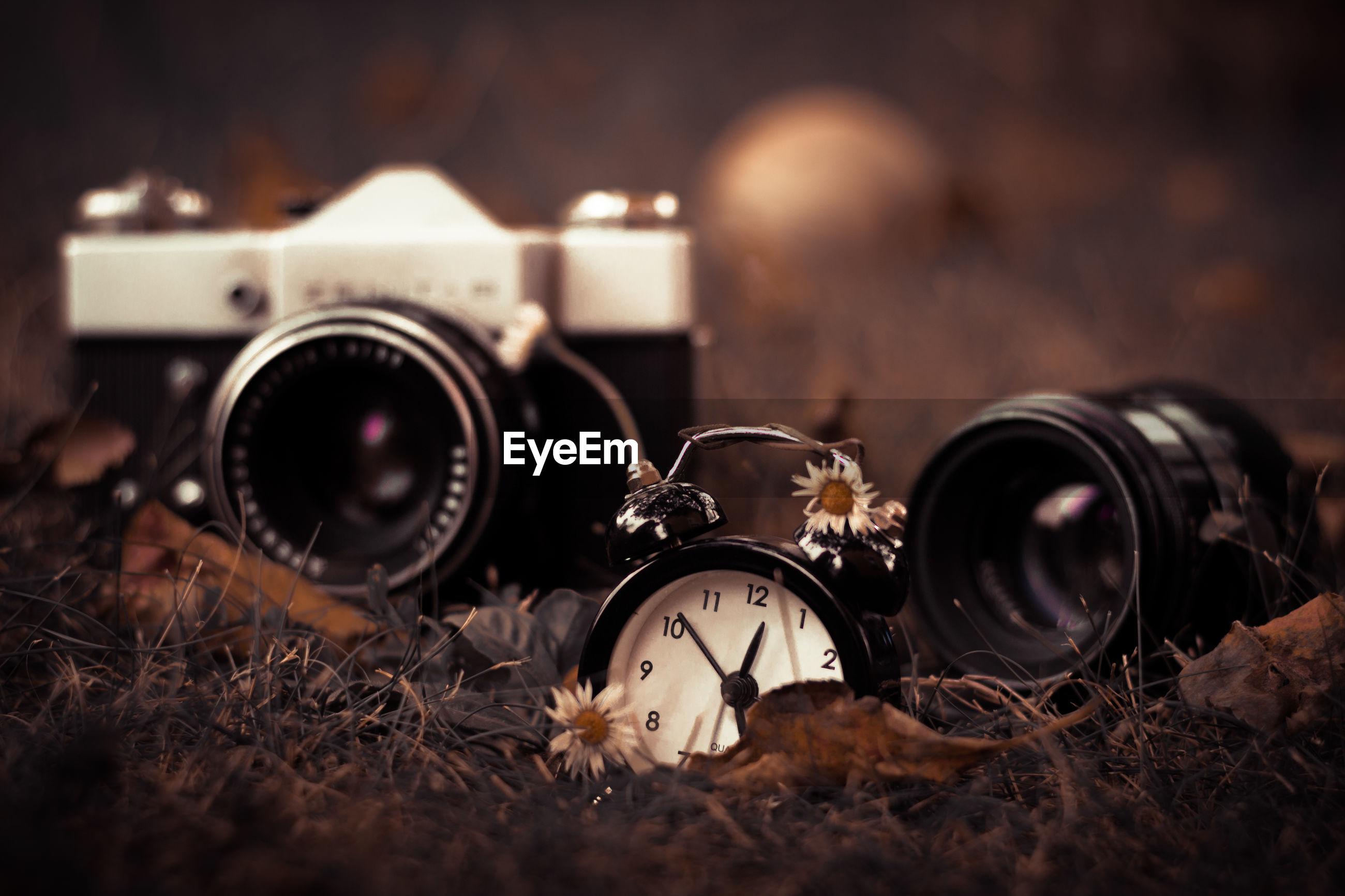 Close-up of clock and camera