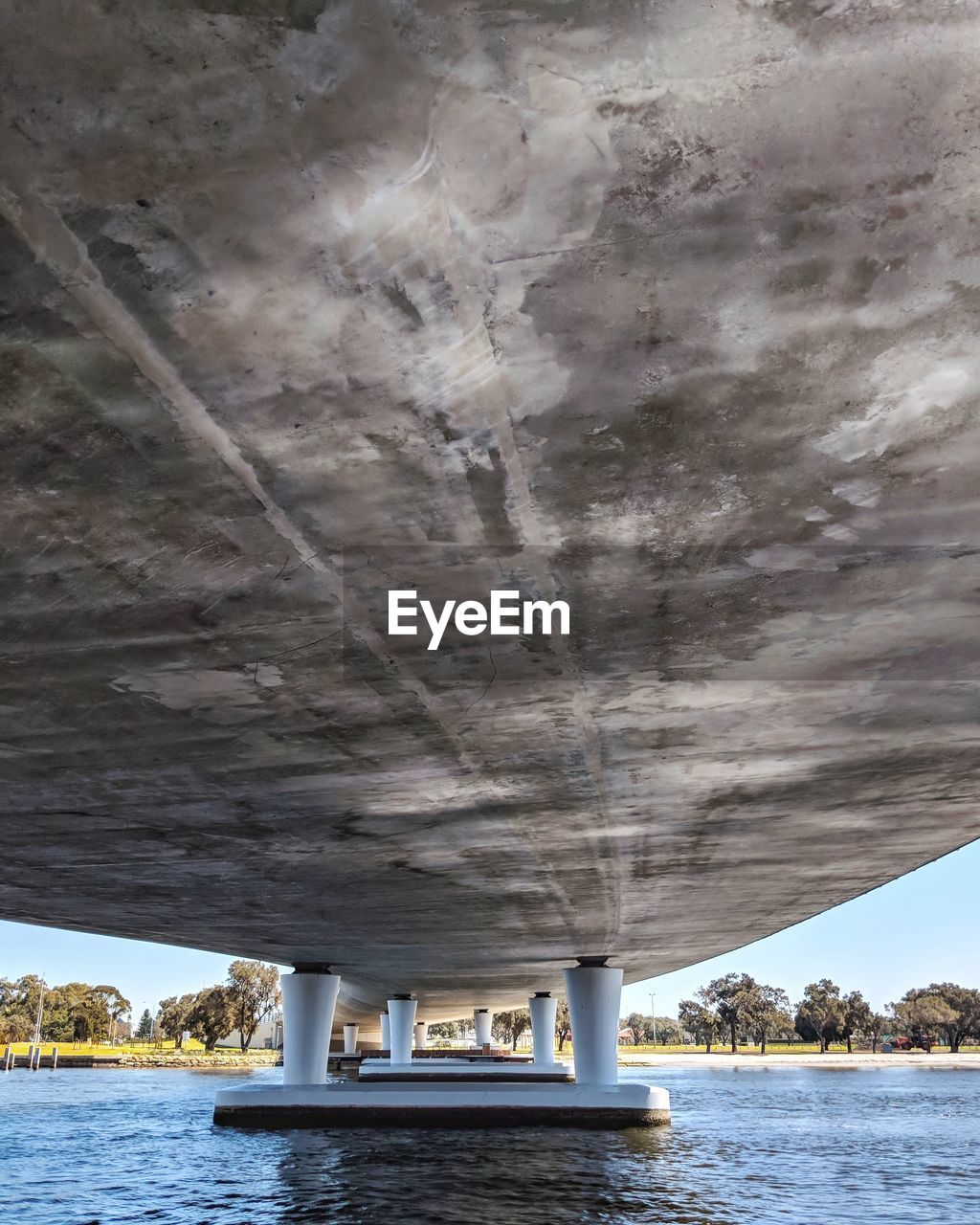 water, waterfront, day, transportation, no people, nature, sea, built structure, bridge, architecture, connection, sky, architectural column, outdoors, below, bridge - man made structure, scenics - nature, underneath