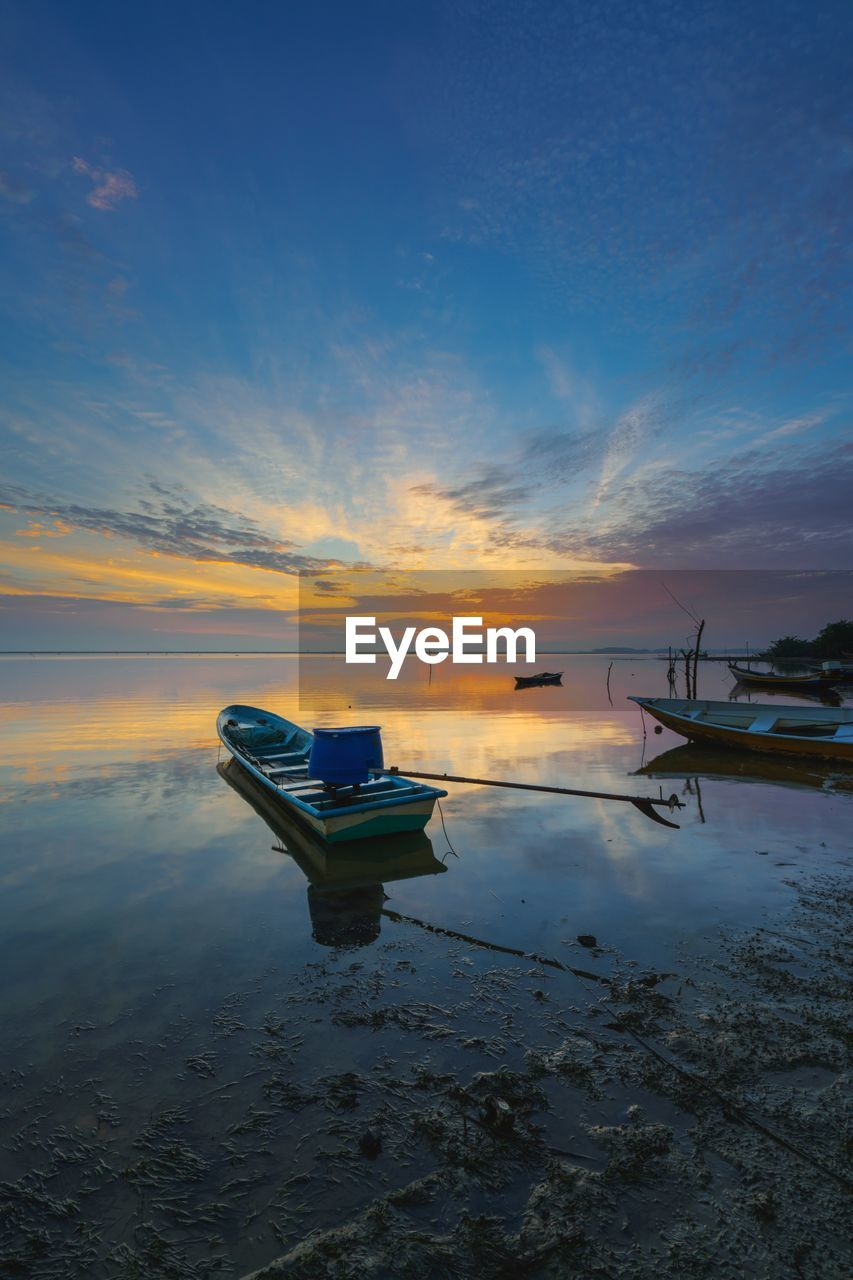 sunset, water, sky, nature, tranquility, beauty in nature, scenics, cloud - sky, sea, tranquil scene, reflection, beach, nautical vessel, transportation, outdoors, no people, horizon over water, moored, day