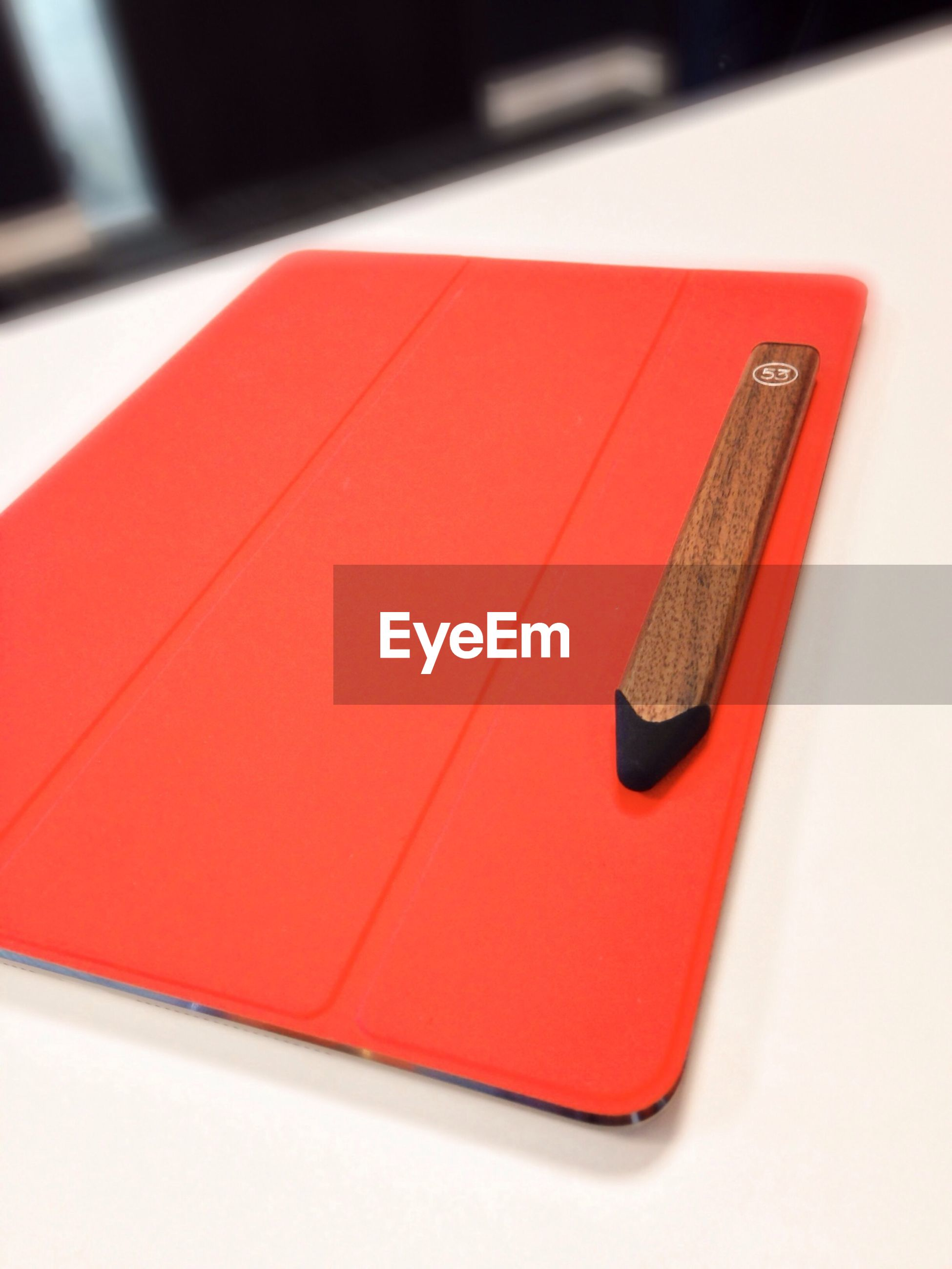 indoors, close-up, red, still life, pen, high angle view, table, single object, pencil, selective focus, no people, music, studio shot, technology, education, connection, arts culture and entertainment, book, office supply, focus on foreground