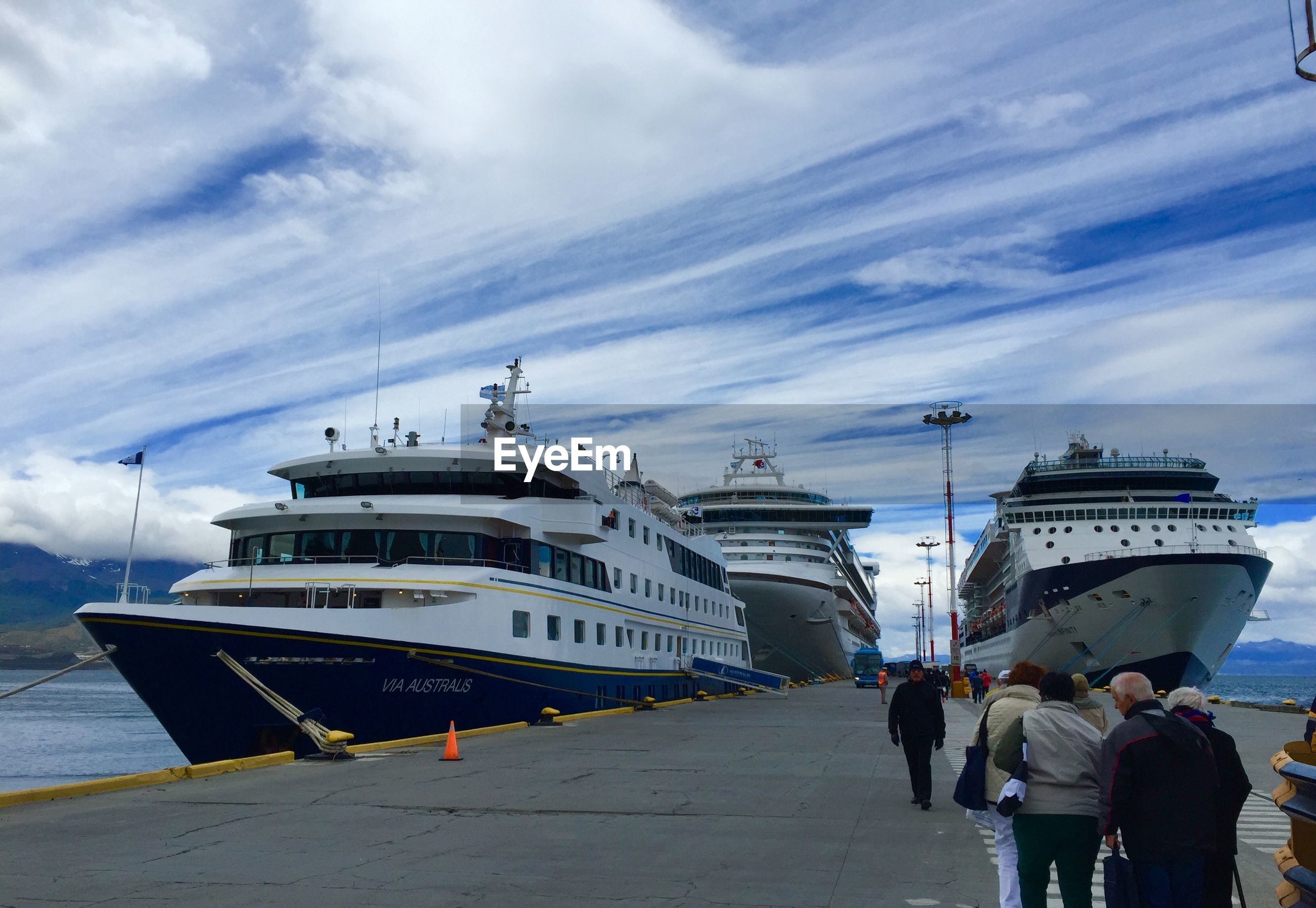 sky, transportation, mode of transport, cloud - sky, men, built structure, architecture, lifestyles, building exterior, water, sea, travel, nautical vessel, person, walking, rear view, cloud, cloudy, day