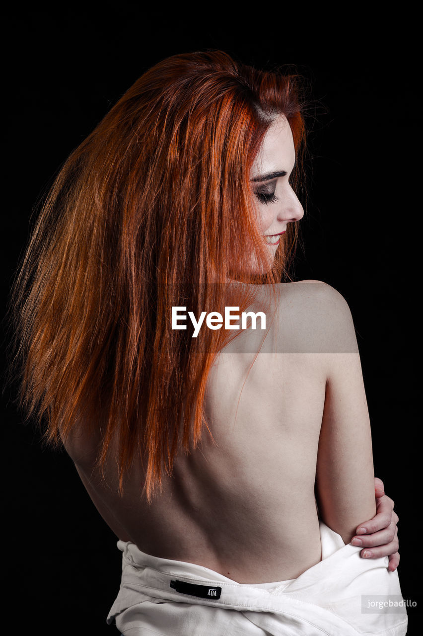 one person, hairstyle, young adult, studio shot, black background, redhead, long hair, women, young women, indoors, hair, fashion, adult, beautiful woman, beauty, looking, casual clothing, leisure activity, dyed hair, dyed red hair