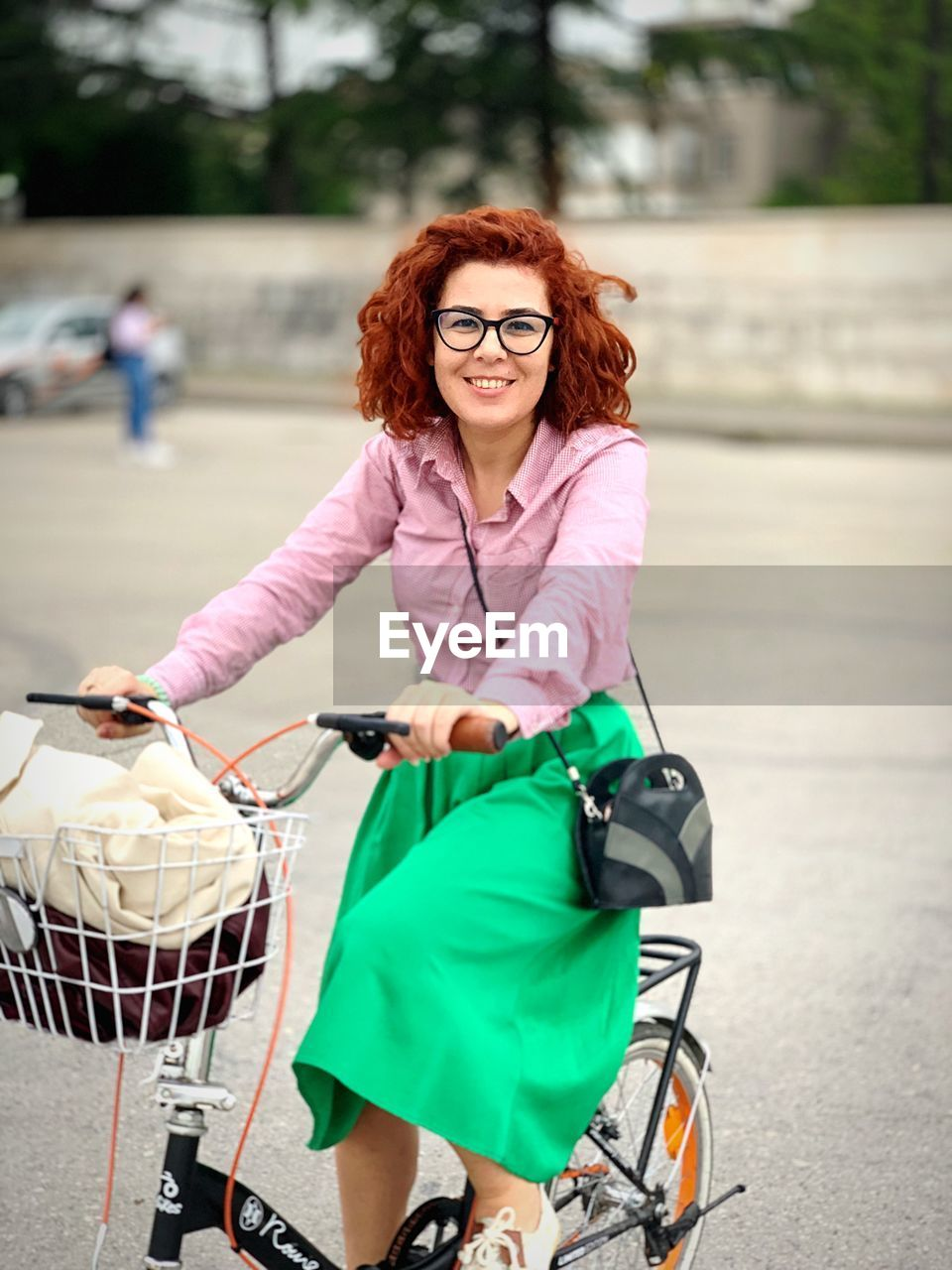 bicycle, real people, one person, women, lifestyles, glasses, transportation, adult, focus on foreground, sport, young adult, casual clothing, front view, day, basket, land vehicle, full length, females, hairstyle, outdoors, beautiful woman