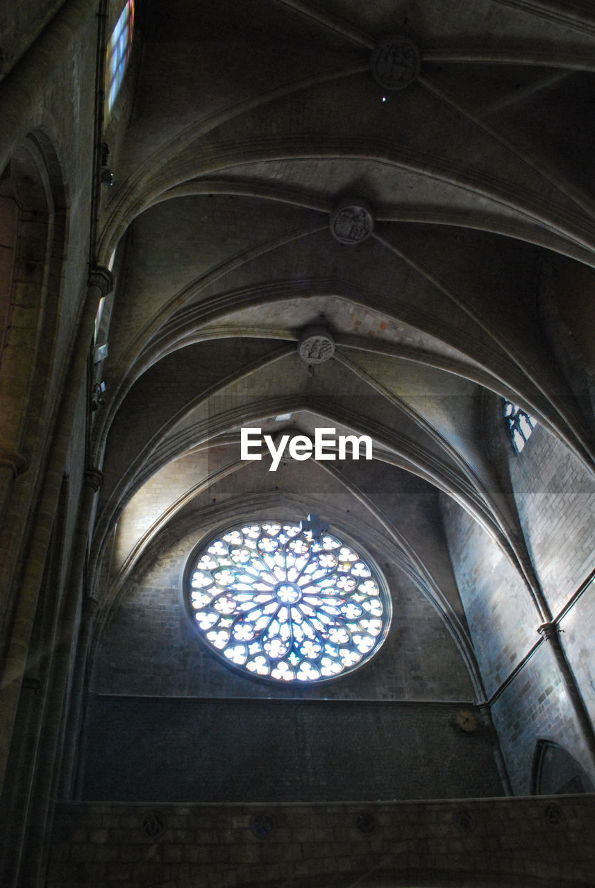 indoors, ceiling, low angle view, place of worship, window, architecture, religion, history, built structure, spirituality, no people, day