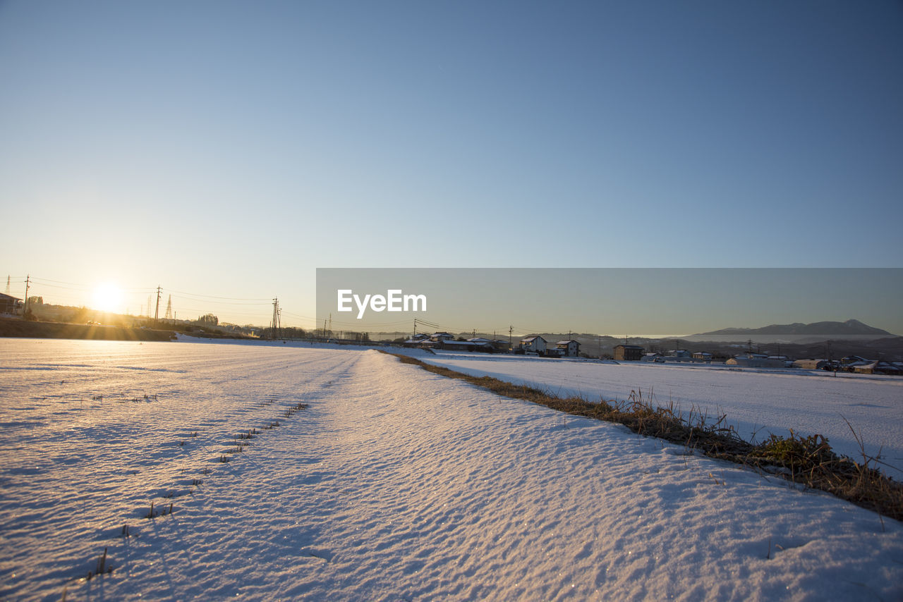 SCENIC VIEW OF CITY AGAINST CLEAR SKY DURING WINTER