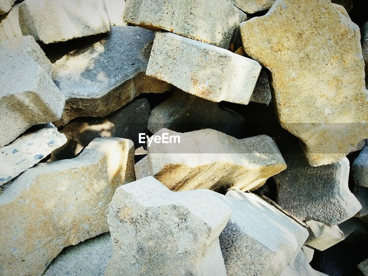 backgrounds, full frame, no people, close-up, large group of objects, nature, abundance, solid, textured, day, pattern, rock, outdoors, rock - object, stack, detail, winter, heap, cold temperature, stone - object