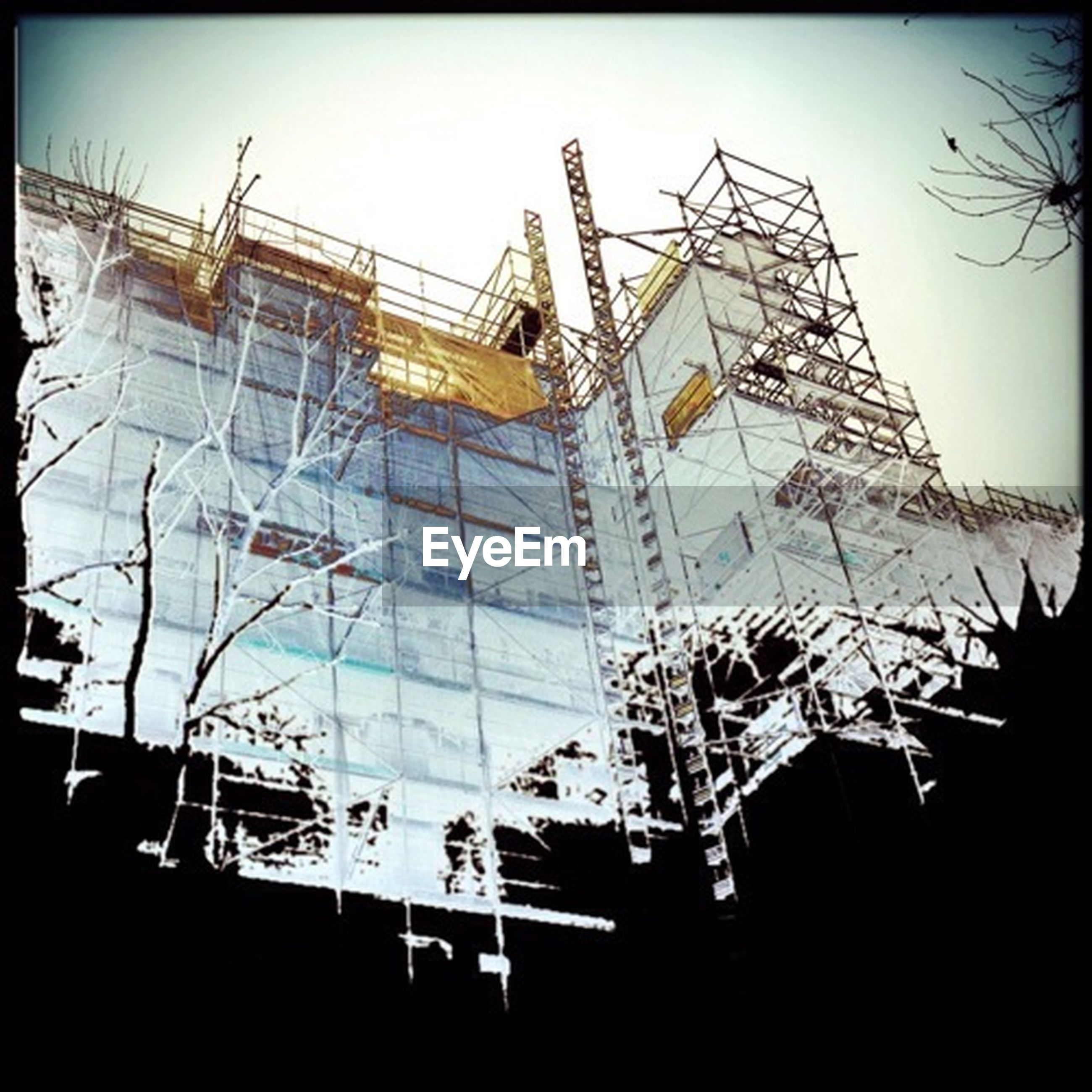 architecture, built structure, building exterior, low angle view, clear sky, auto post production filter, building, transfer print, construction site, day, sky, glass - material, construction, no people, outdoors, development, city, scaffolding, window, crane - construction machinery