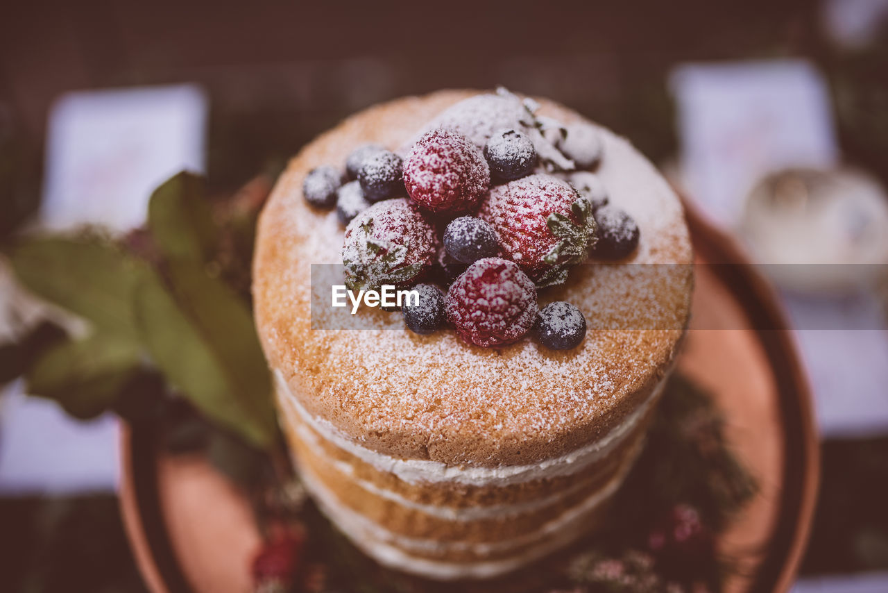 sweet food, indulgence, food and drink, temptation, dessert, food, freshness, unhealthy eating, indoors, ready-to-eat, focus on foreground, table, close-up, no people, plate, fruit, dessert topping, day