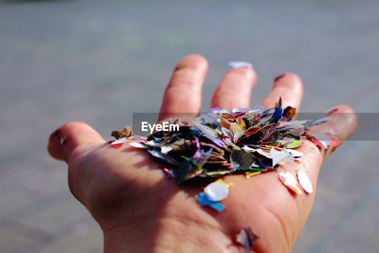 Cropped Image Of Hand Holding Confetti