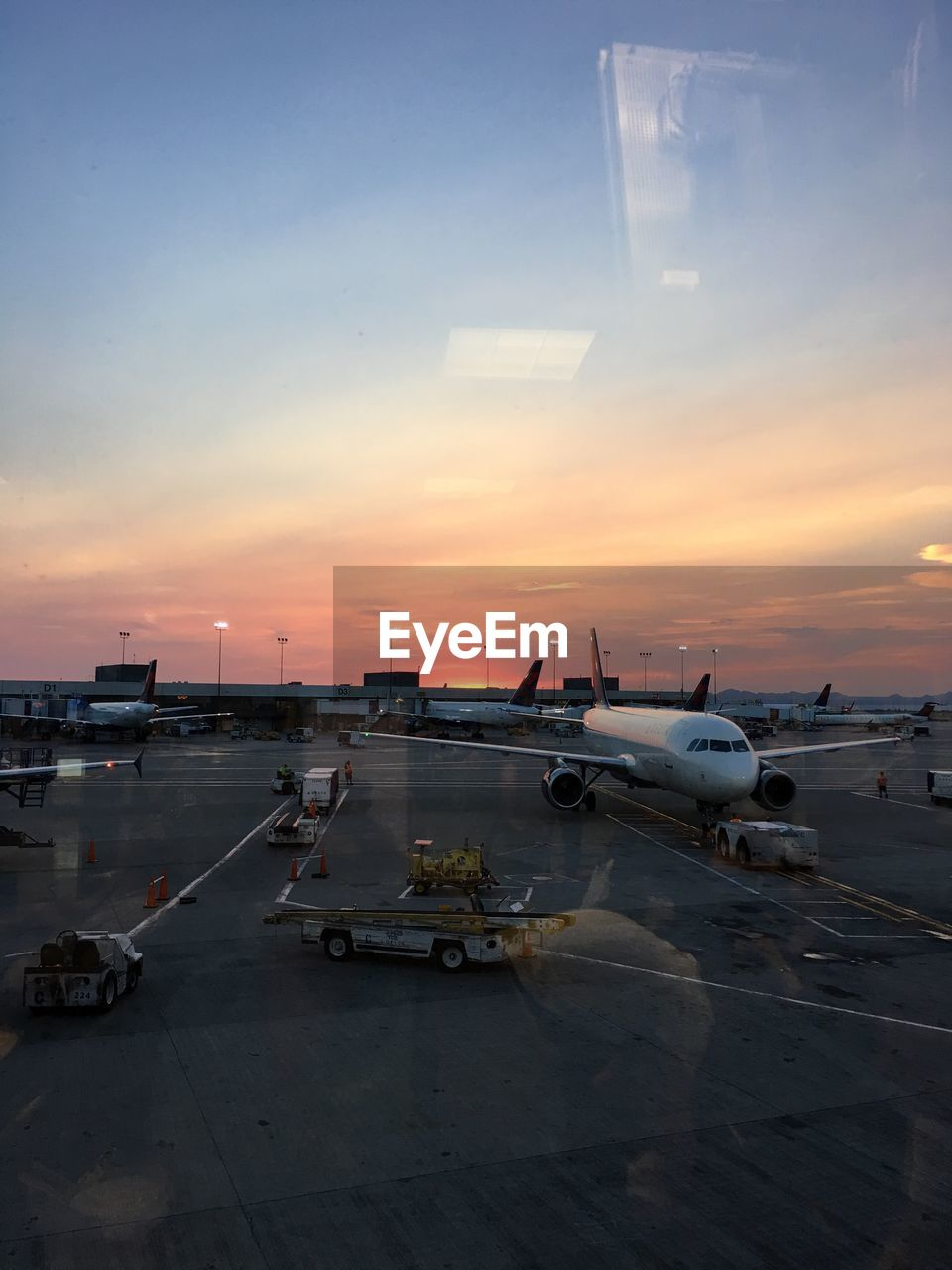 airplane, transportation, sunset, airport runway, airport, air vehicle, sky, mode of transport, cloud - sky, no people, runway, travel, outdoors, commercial airplane, day, airplane wing