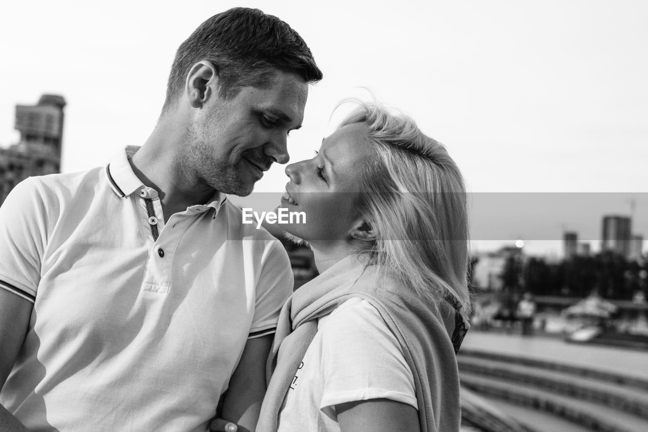 Smiling Couple Standing Against Sky