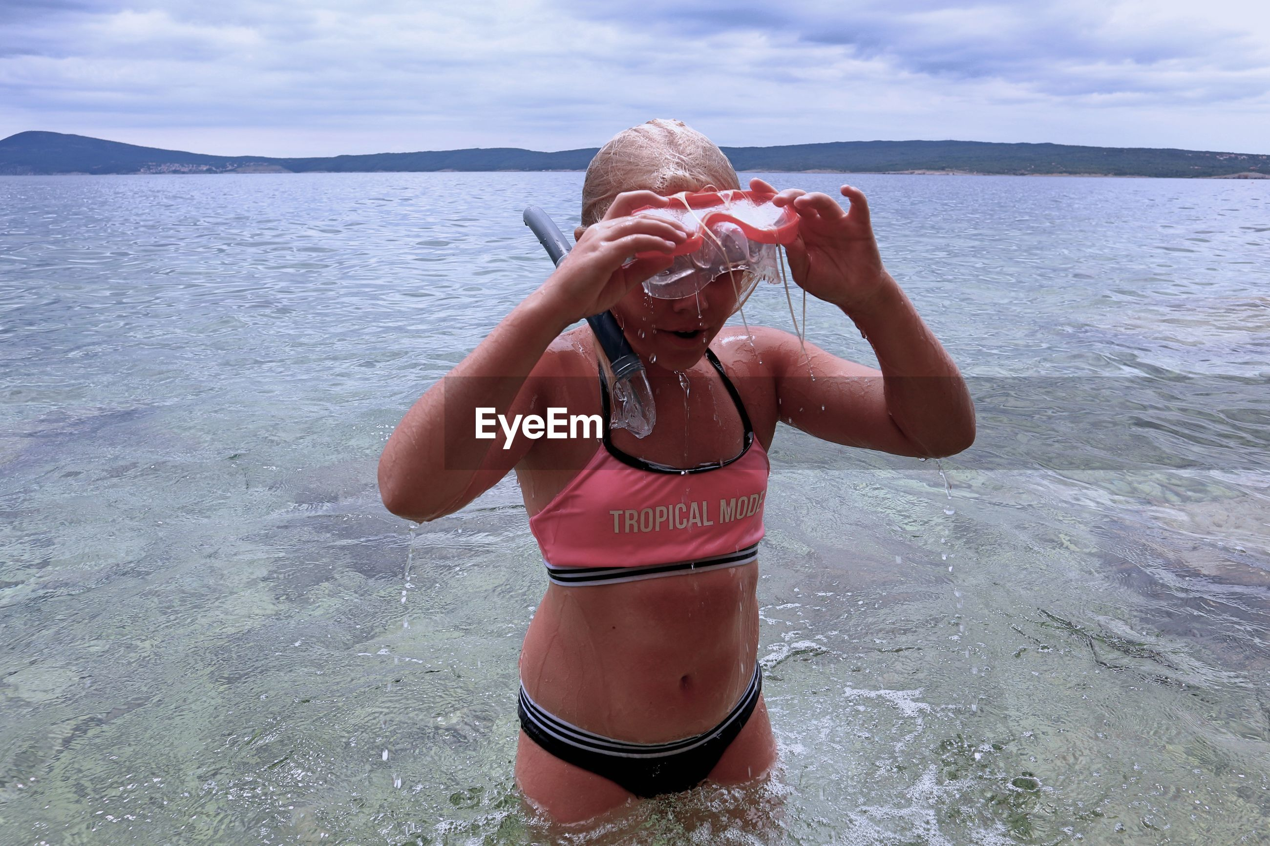 Girl with snorkel in sea