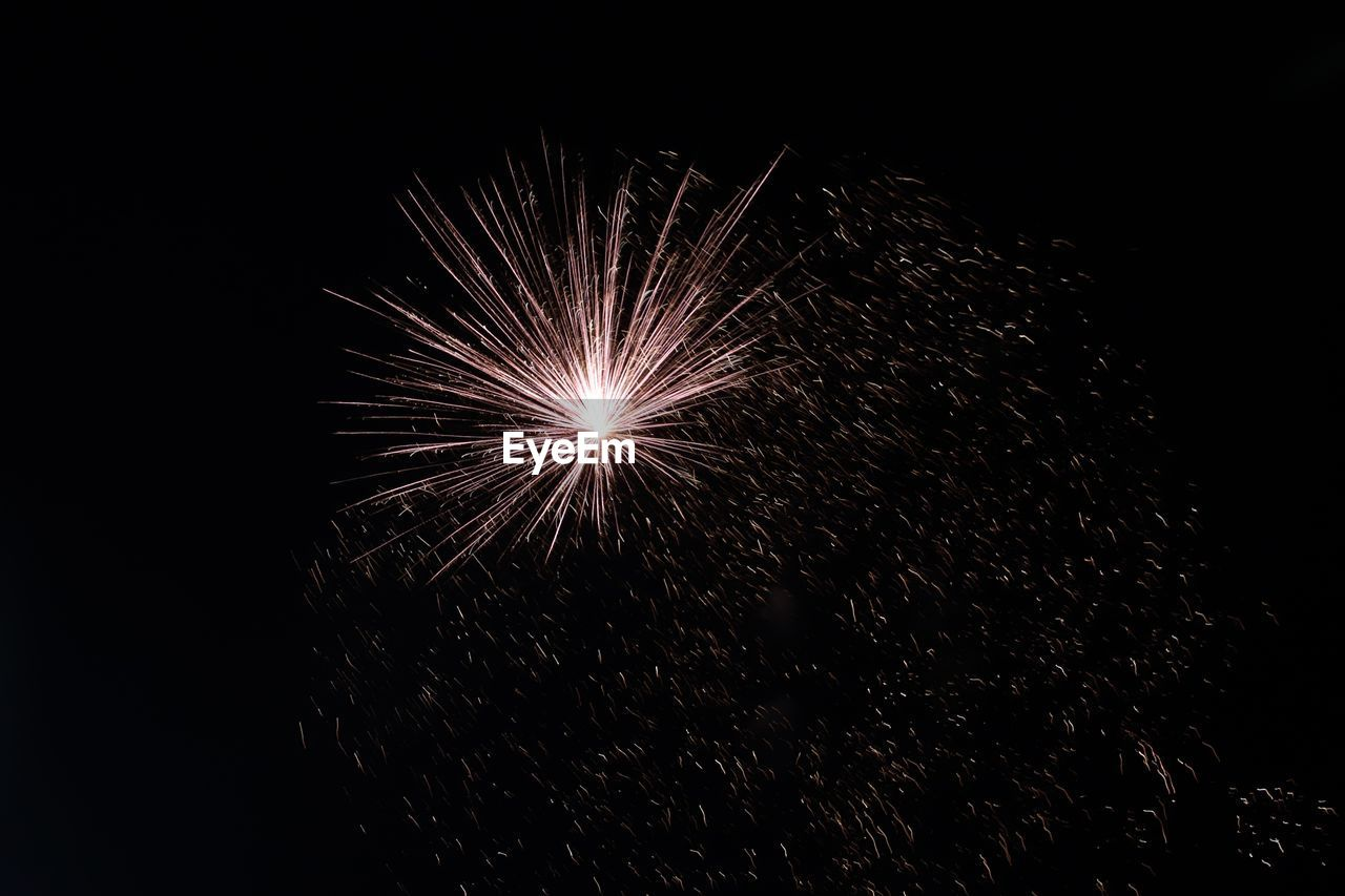 night, firework, arts culture and entertainment, firework display, illuminated, event, motion, exploding, low angle view, celebration, sky, no people, glowing, firework - man made object, long exposure, light, nature, dark, blurred motion, sparks, black background