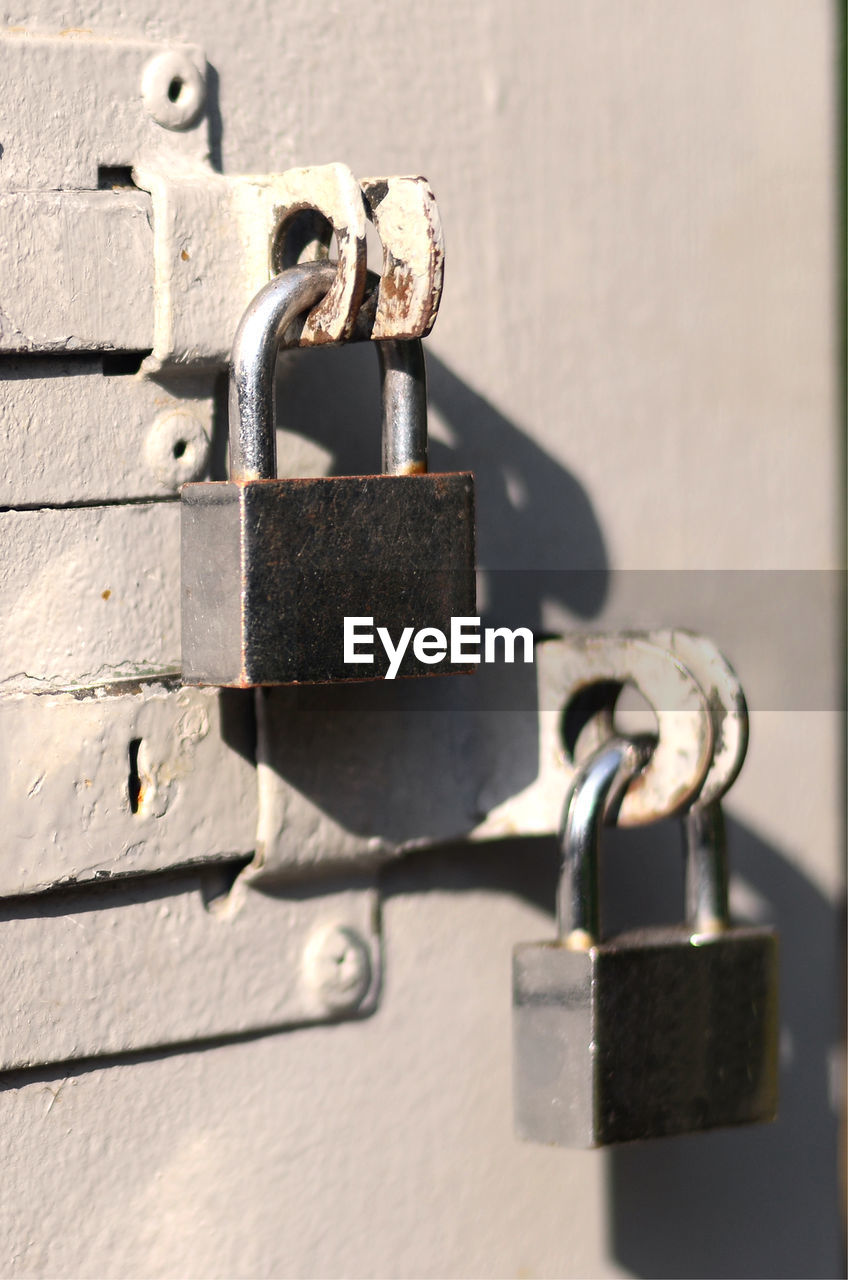 metal, lock, safety, protection, security, sunlight, padlock, close-up, day, no people, shadow, focus on foreground, connection, outdoors, latch, rusty, entrance, door, technology, wall - building feature, silver colored