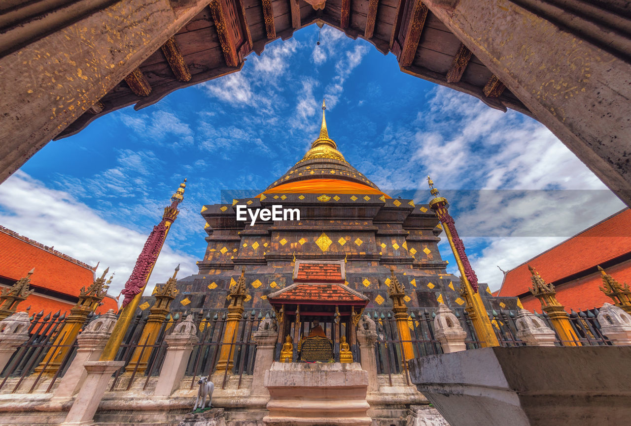 architecture, religion, place of worship, built structure, sky, building exterior, pagoda, travel destinations, gold colored, low angle view, spirituality, cloud - sky, gold, history, palace, day, no people, outdoors, ancient civilization