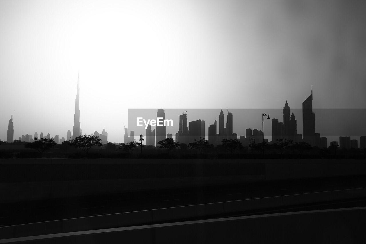 Burj Khalifa Amidst Modern Buildings Against Clear Sky