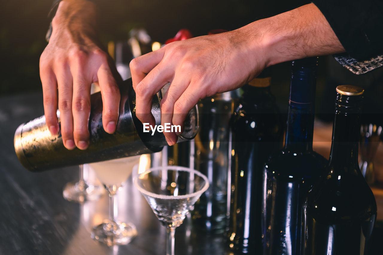Close-up of bartender making drink