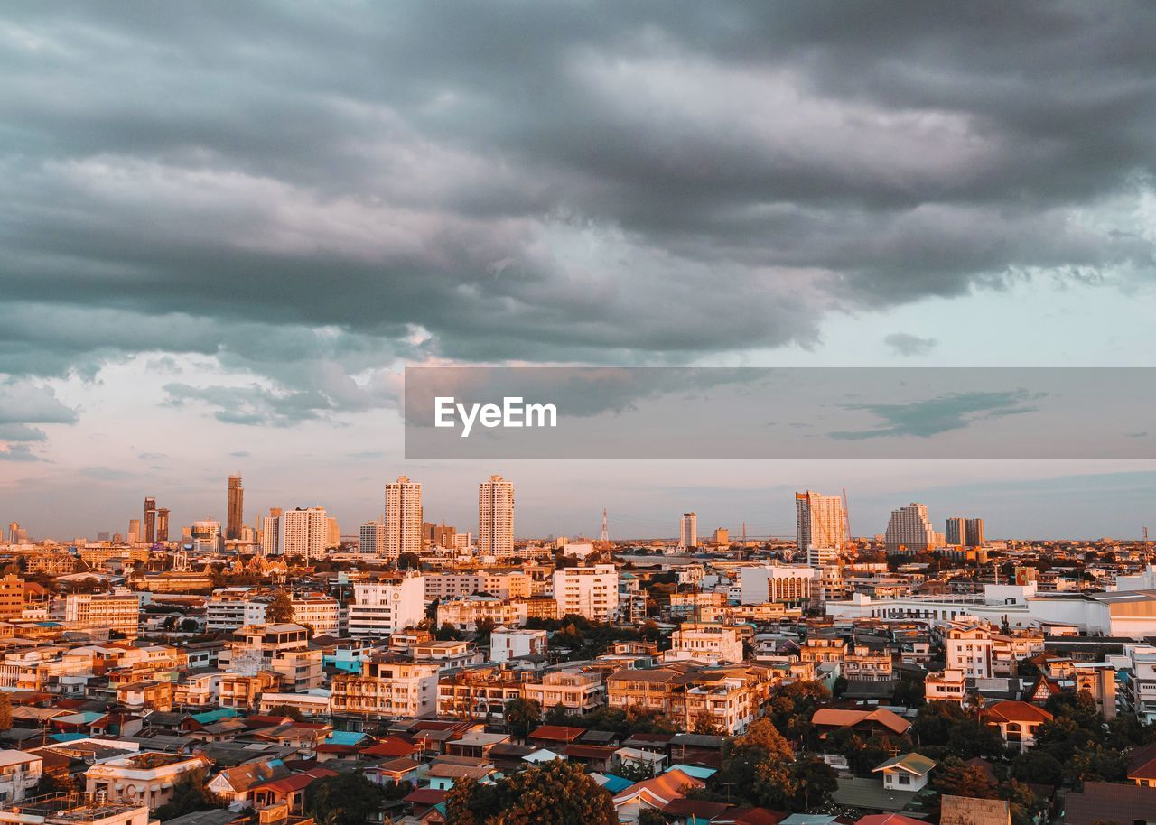 cloud - sky, architecture, sky, building exterior, built structure, cityscape, building, city, residential district, crowded, nature, overcast, high angle view, day, outdoors, storm cloud, urban skyline, office building exterior, skyscraper, ominous, settlement