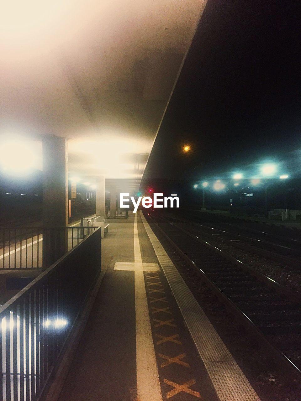illuminated, transportation, rail transportation, railroad track, night, public transportation, no people, indoors, sky, architecture
