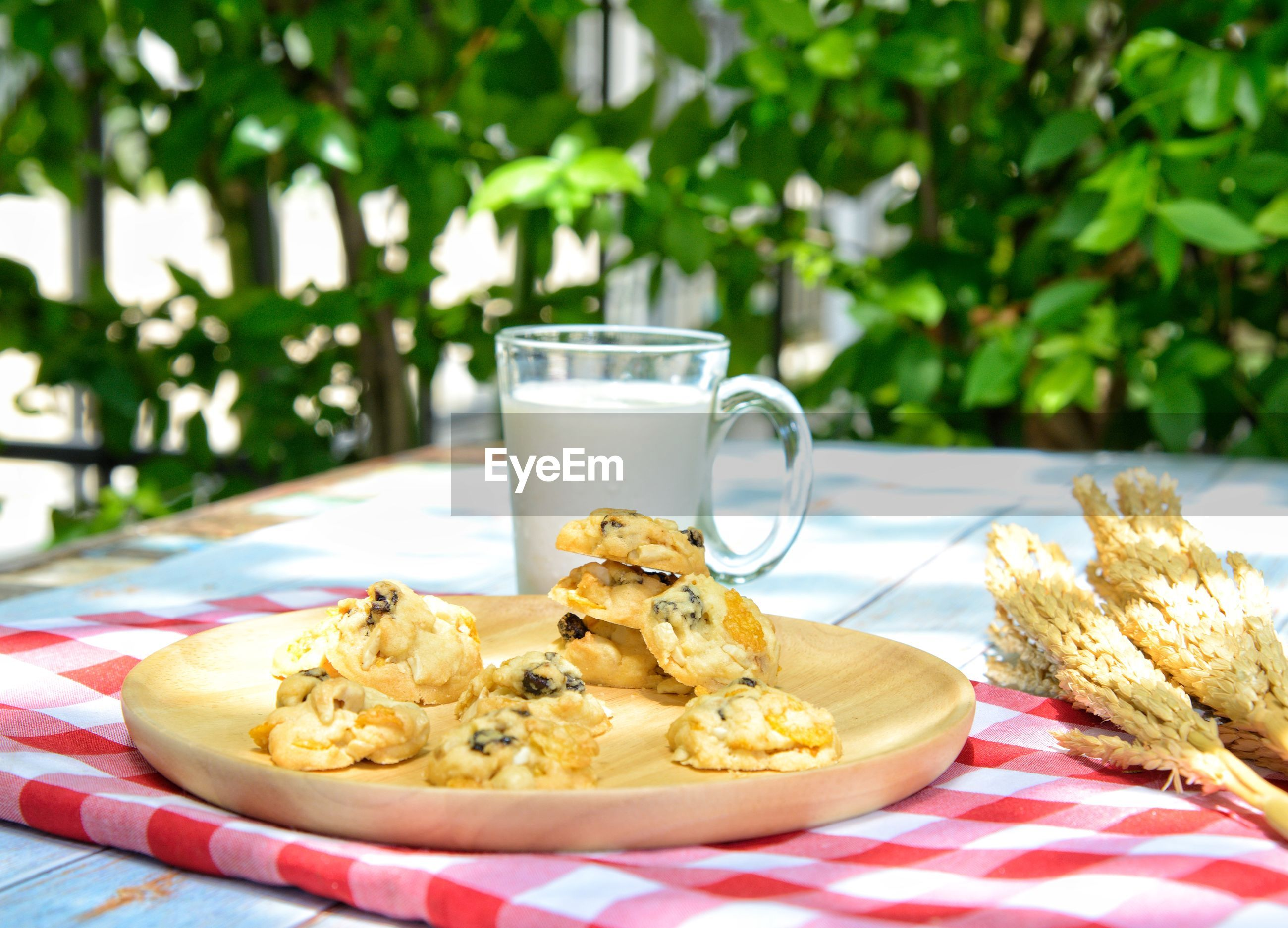 Butter cookies with milk and tasty and delicious beverages are placed on wooden trays