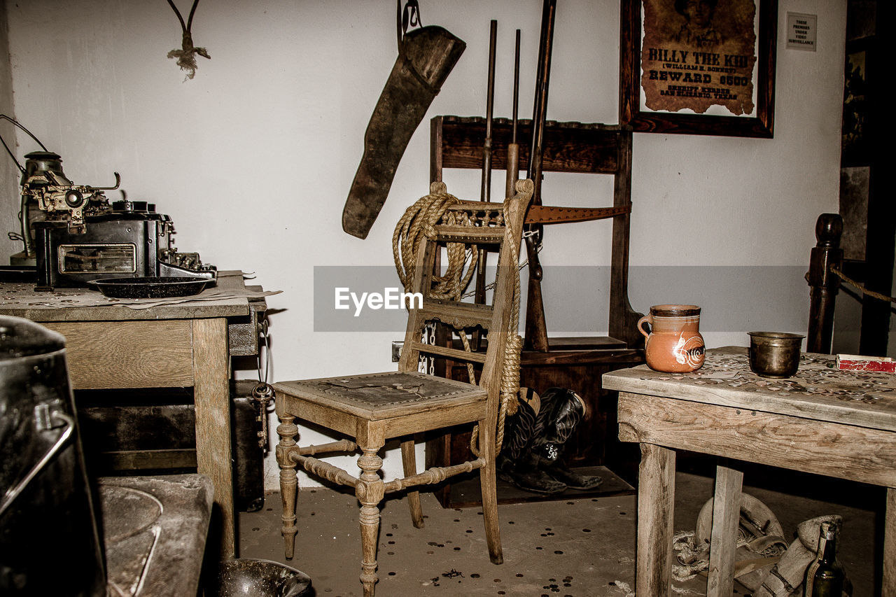 table, seat, old, chair, no people, indoors, wood - material, architecture, container, furniture, building, day, absence, abandoned, domestic room, antique, house, built structure, wall - building feature