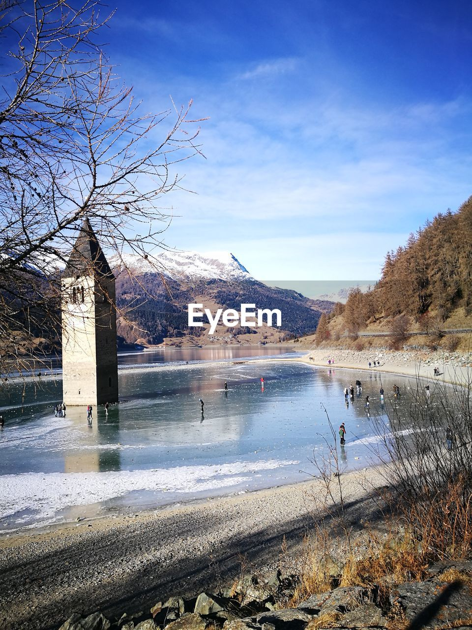 water, lake, nature, beauty in nature, scenics, winter, bare tree, mountain, cold temperature, tranquil scene, tranquility, outdoors, tree, day, no people, sky, snow, landscape, mountain range