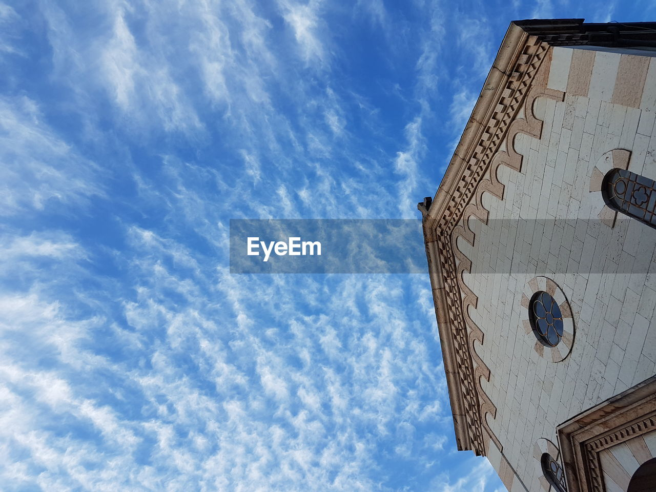 low angle view, cloud - sky, sky, religion, architecture, built structure, spirituality, no people, day, place of worship, building exterior, outdoors
