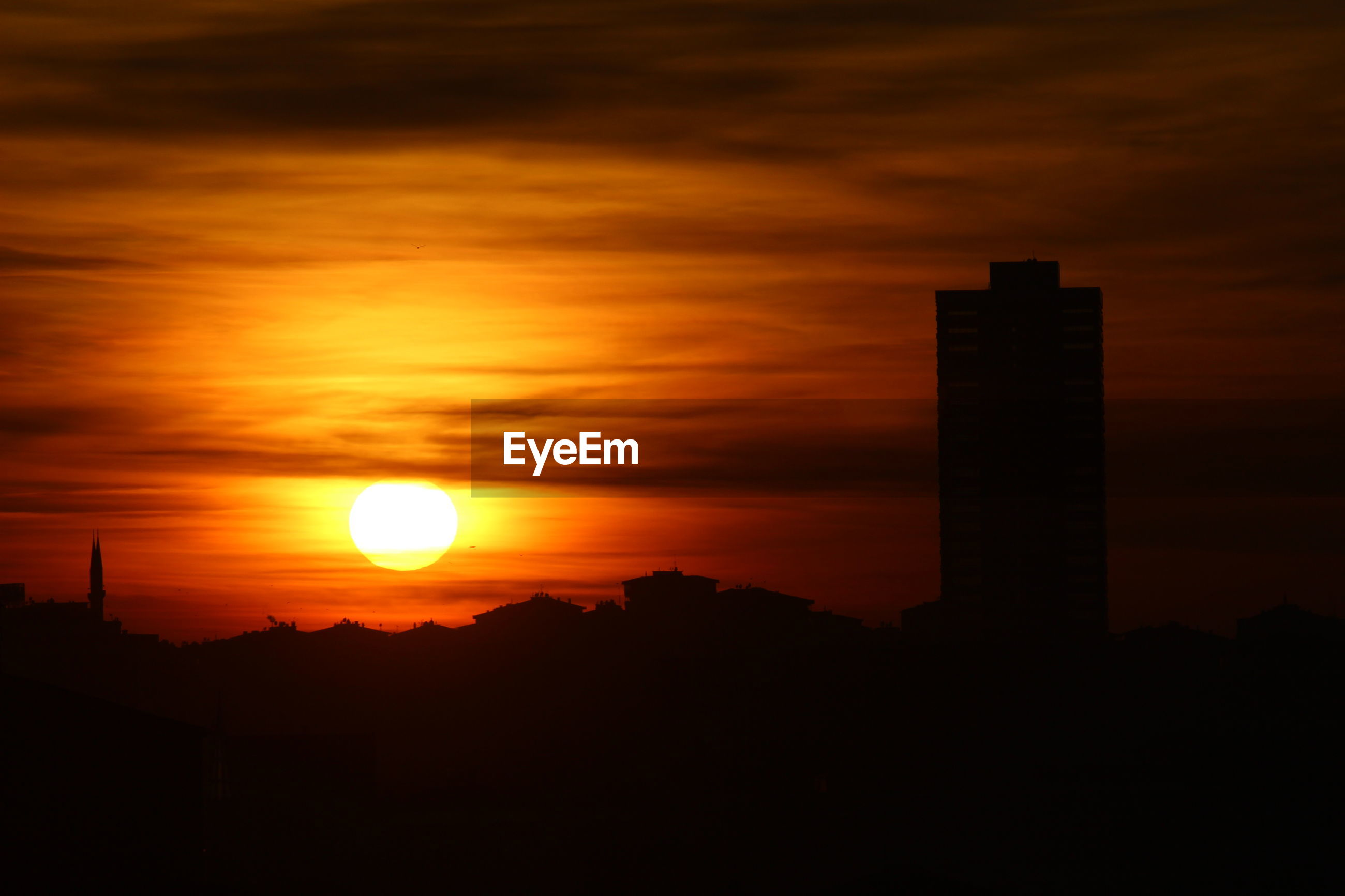 sunset, silhouette, orange color, sun, sky, building exterior, architecture, built structure, scenics, beauty in nature, cloud - sky, idyllic, dark, nature, dramatic sky, tranquil scene, tranquility, cloud, sunlight, moody sky