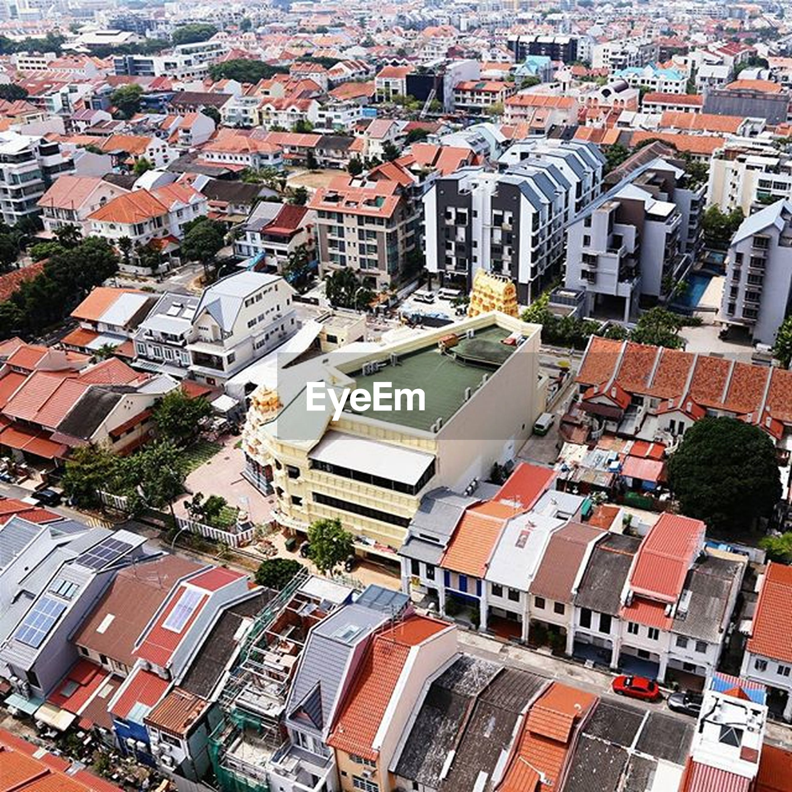 building exterior, architecture, built structure, high angle view, cityscape, city, crowded, residential district, aerial view, residential structure, residential building, roof, city life, elevated view, house, town, townscape, day, outdoors, community