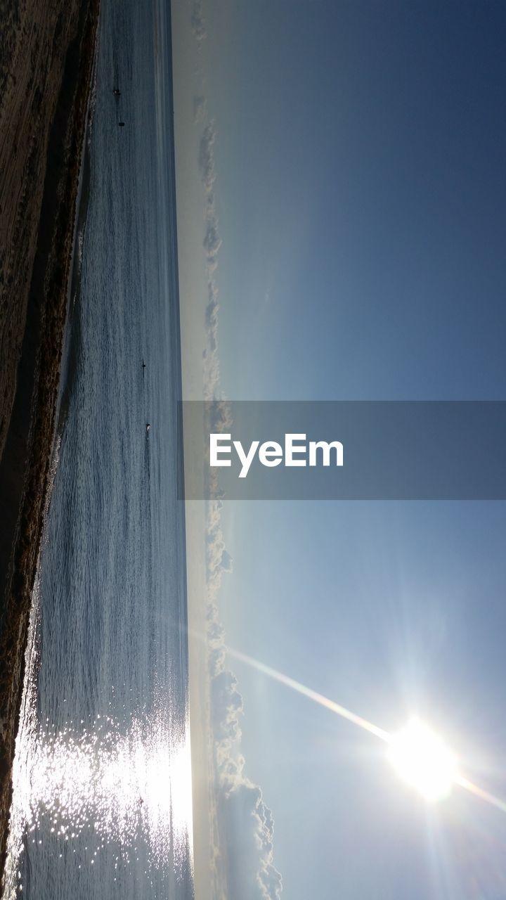 sky, beauty in nature, scenics - nature, sun, water, no people, nature, sunlight, tranquil scene, tranquility, day, sea, cloud - sky, sunset, non-urban scene, sunbeam, outdoors, land, beach, horizon over water