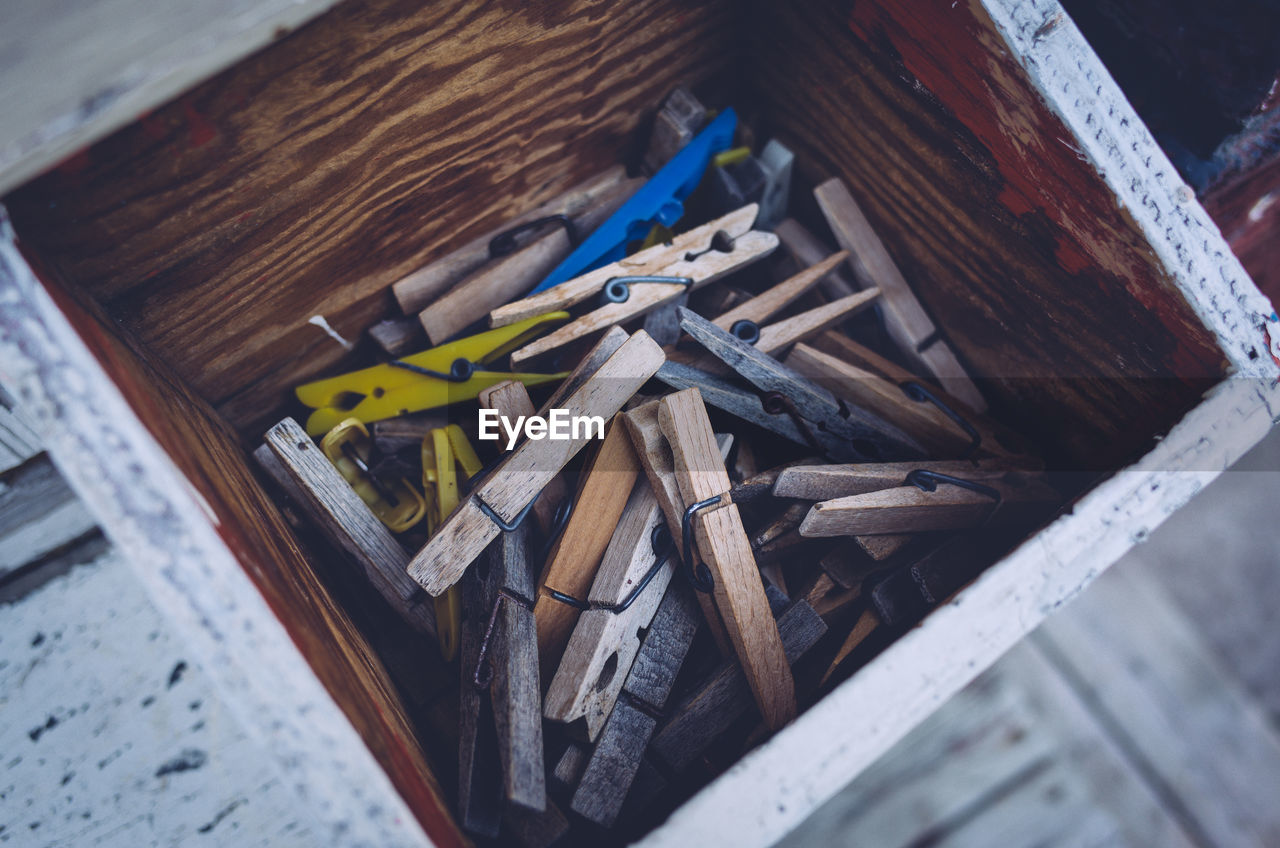 High Angle View Of Clothespin In Container