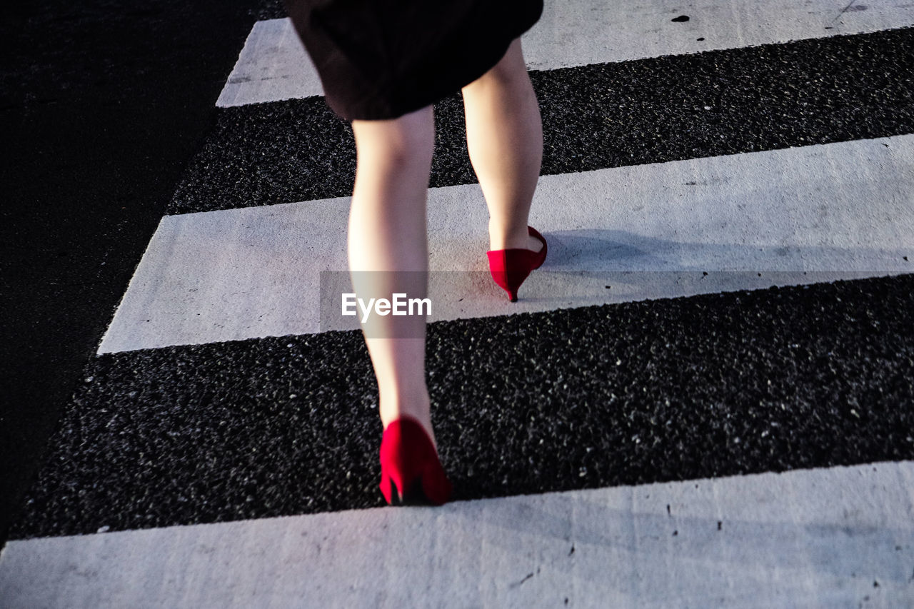 Low Section Of Woman In Red High Heels