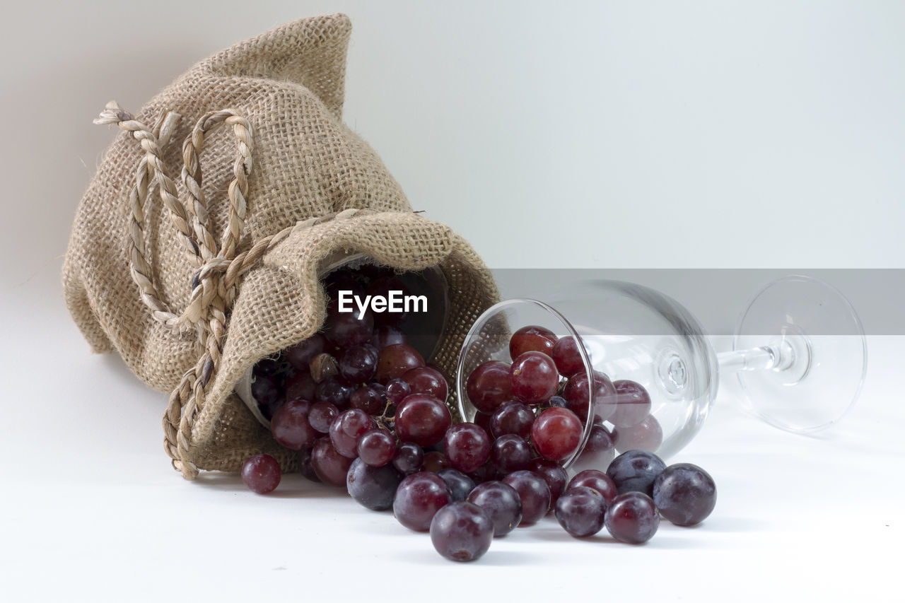 food and drink, food, still life, close-up, white background, indoors, table, freshness, healthy eating, studio shot, no people, wellbeing, fruit, container, grape, copy space, glass - material, textile, transparent, red