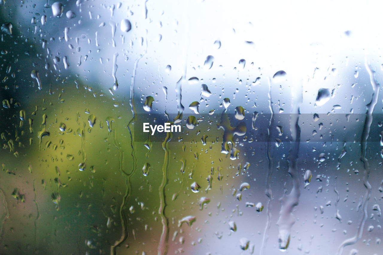 drop, wet, water, glass - material, rain, window, transparent, no people, indoors, close-up, nature, rainy season, raindrop, full frame, sky, focus on foreground, backgrounds, day, glass