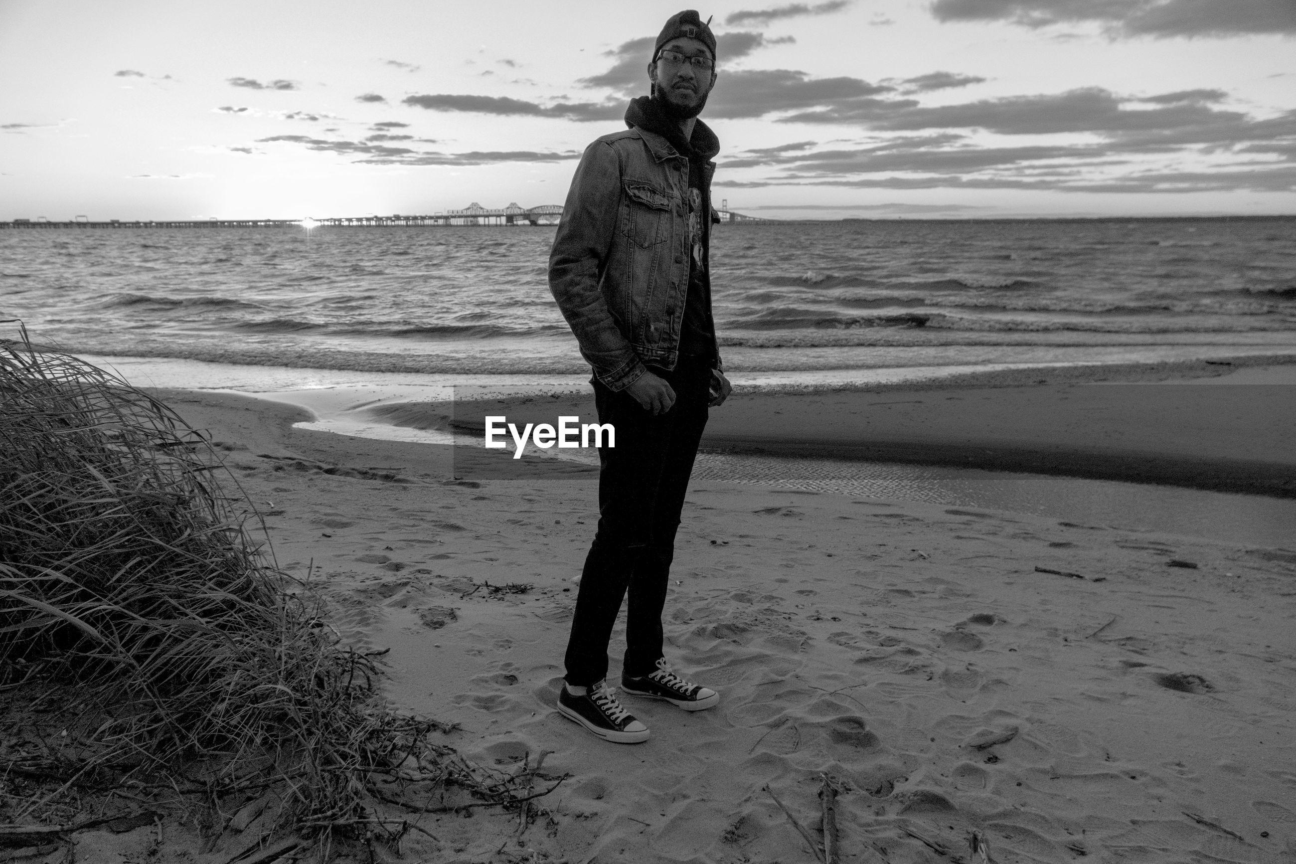 Full length of man standing at beach