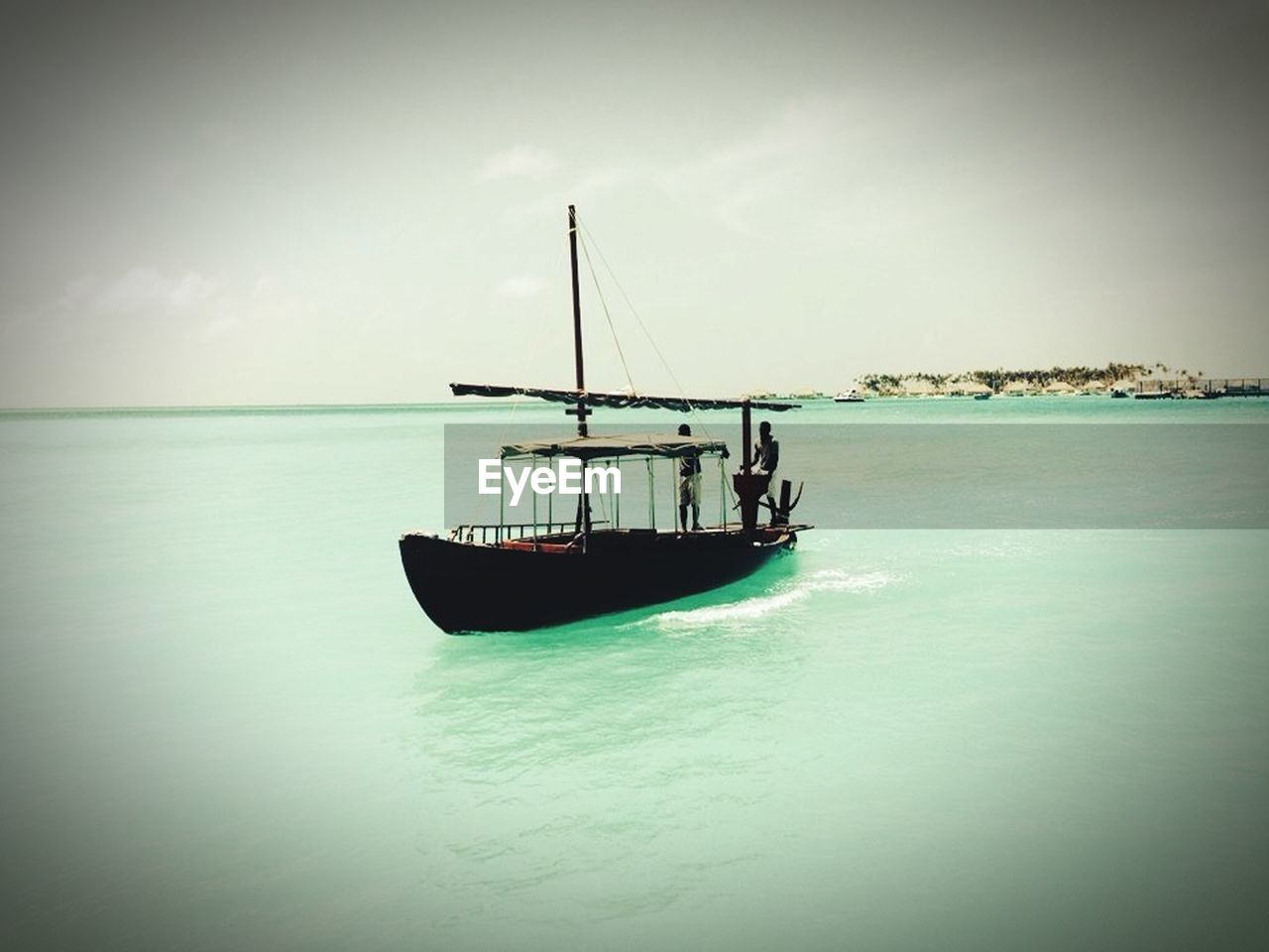 nautical vessel, transportation, sea, water, mode of transport, nature, boat, beauty in nature, sky, scenics, waterfront, horizon over water, tranquility, tranquil scene, moored, outdoors, no people, day, beach, sailing