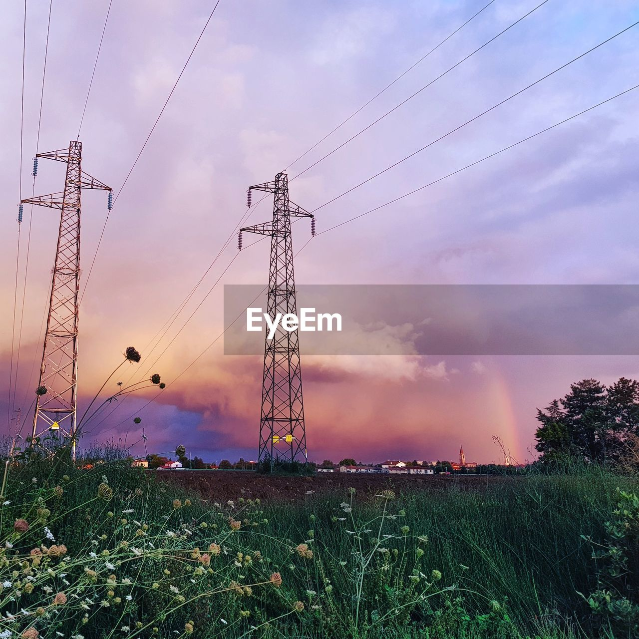 sky, electricity, fuel and power generation, cable, technology, electricity pylon, cloud - sky, power supply, power line, field, connection, plant, land, nature, sunset, grass, environment, no people, landscape, low angle view, outdoors, complexity, electrical equipment
