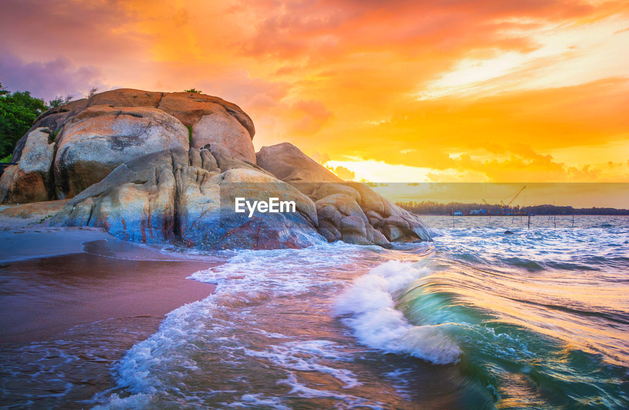 sunset, sea, beauty in nature, sky, scenics, water, nature, rock - object, rock formation, tranquil scene, tranquility, cloud - sky, outdoors, no people, waterfront, wave, beach, horizon over water, day
