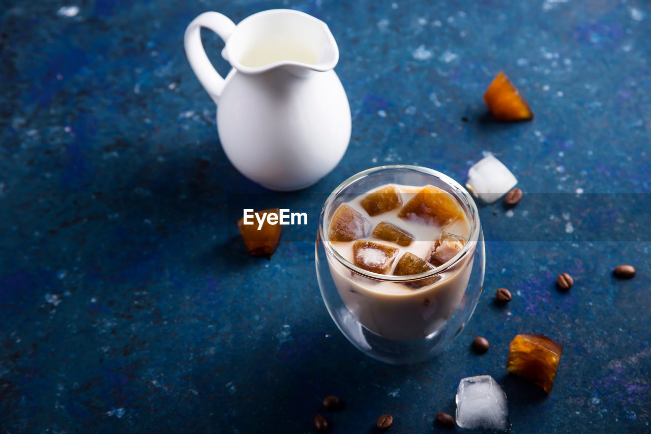 food and drink, drink, refreshment, food, still life, table, high angle view, cup, freshness, coffee, no people, indoors, coffee - drink, mug, blue, hot drink, container, coffee cup, dairy product, milk, glass, latte, breakfast