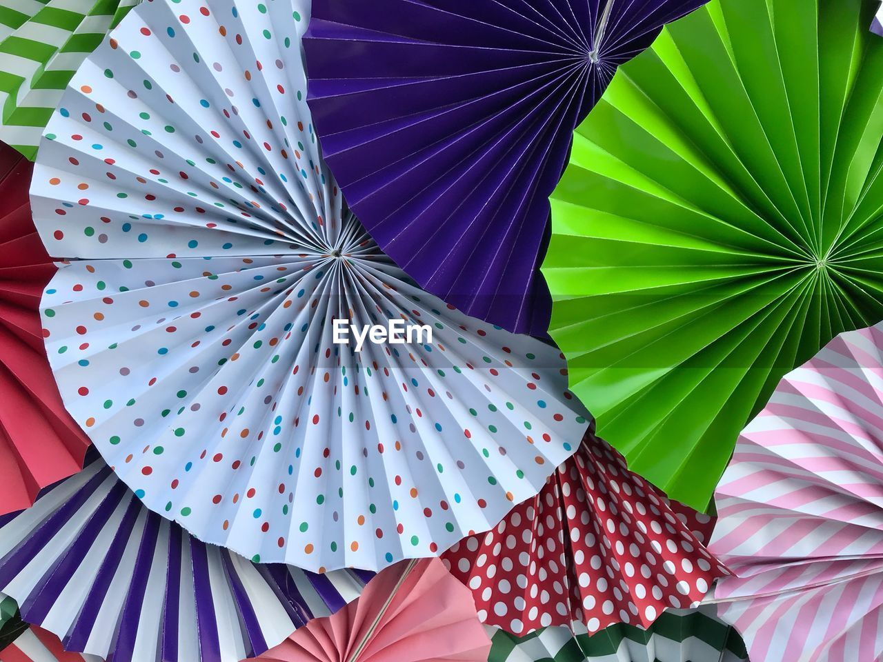 umbrella, protection, security, pattern, no people, multi colored, day, close-up, low angle view, still life, pink color, parasol, full frame, outdoors, decoration, backgrounds, design, safety, nature, floral pattern, purple
