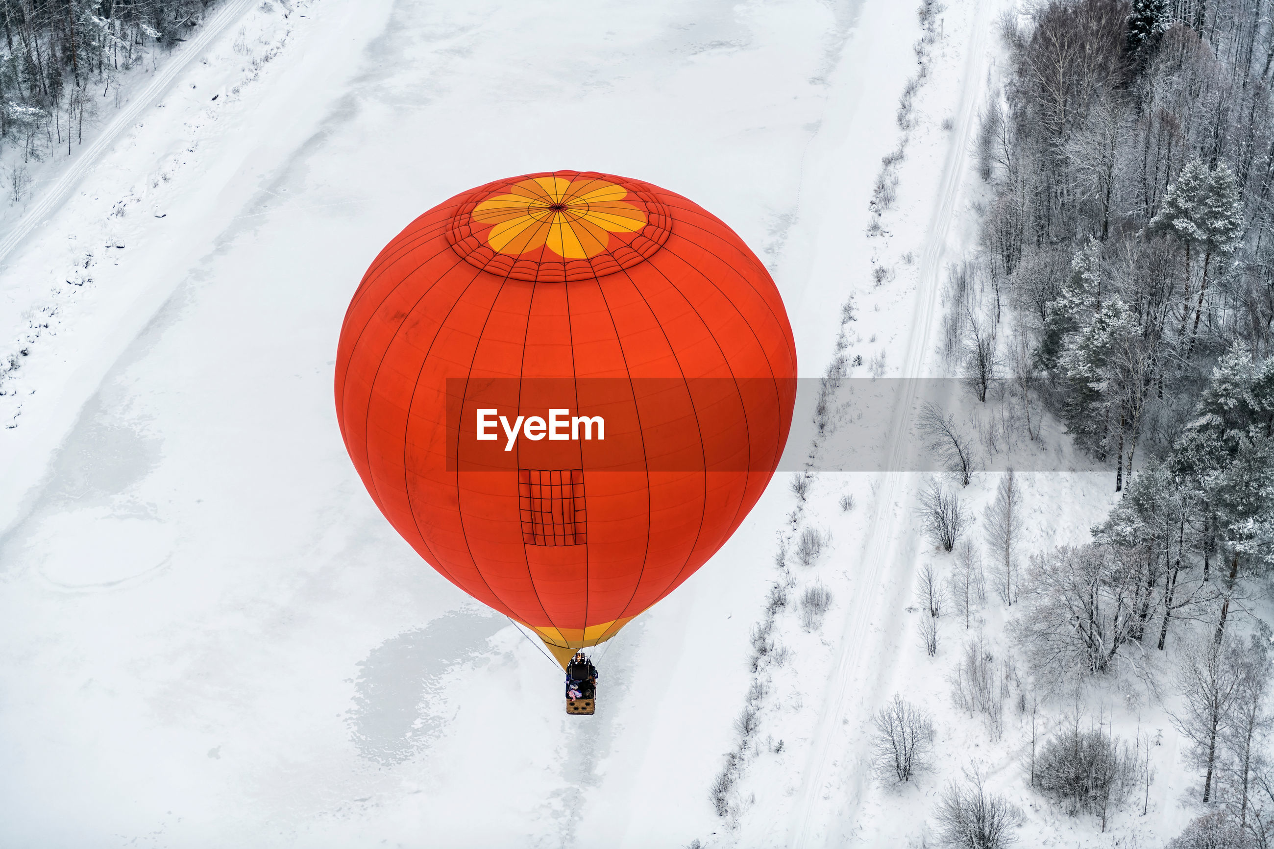 Aerial view of hot air balloon over snow landscape