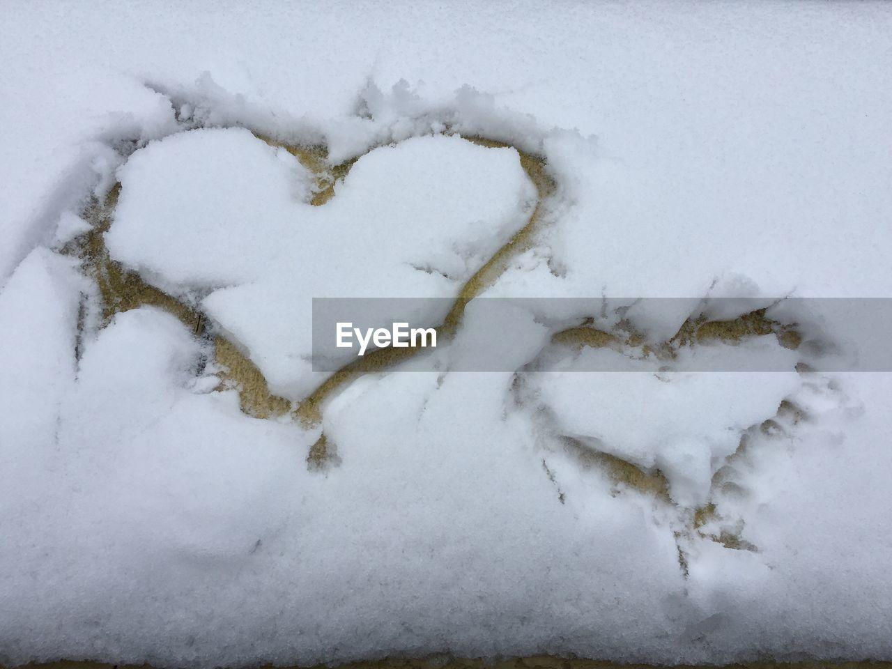 snow, winter, white color, cold temperature, heart shape, nature, no people, love, day, emotion, beauty in nature, positive emotion, frozen, field, covering, close-up, land, outdoors, art and craft, powder snow
