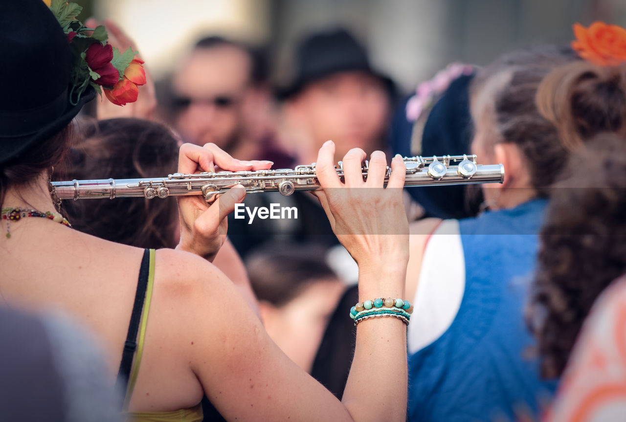 Woman Playing Flute During Event